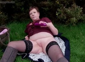 Mature exhibitionist takes off and..